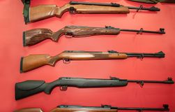 Different types of rifles on the red wall Royalty Free Stock Image