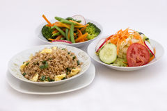 3 different types of salads: fried rice (arroz chaufa), fresh salad (tomatoes, cabage), brocoli salad Royalty Free Stock Photo