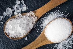 Different types of salt. Top view on two wooden spoons Royalty Free Stock Photos
