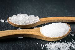 Different types of salt. Top view on two wooden spoons Royalty Free Stock Image