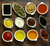 Different types of sauces and oils in bowls stock image