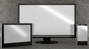 Different types of screens on concrete background. Front view. Stock Photos