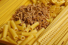 Different types and shapes of Italian pasta Royalty Free Stock Images