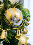 Different types of shiny Christmas toys on a Christmas tree. Close up shot royalty free stock photography