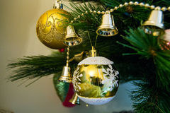 Different types of shiny Christmas toys on a Christmas tree. Close up shot stock photography