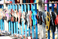 Different types of slippers. Many colorful home slippers in the market Stock Image