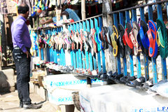 Different types of slippers. Many colorful home slippers in the market Royalty Free Stock Photos