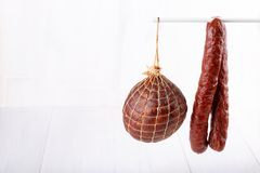 Different types of smoked salami sausages on white royalty free stock photos