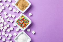 Different types of sugar on magenta background Royalty Free Stock Photo