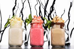 Different types of summer smoothies chia pudding parfait with berry smoothie and fruits inside royalty free stock photography