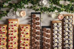 Different types of sweet dessert on board, patisserie, healthy cakes.  royalty free stock images