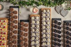 Different types of sweet dessert on board, patisserie, healthy cakes Stock Photo