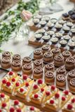 Different types of sweet dessert on board, patisserie, healthy cakes Royalty Free Stock Photography