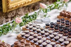 Different types of sweet dessert on board, patisserie, healthy cakes Stock Photos