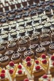 Different types of sweet dessert on board, patisserie, healthy cakes Royalty Free Stock Images
