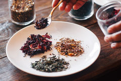 Different types of tea (Hibiscus, green, herbal). Several sorts of Chinese herbal tea. The waiter served a plate, mound the different types of tea (Hibiscus Stock Photo