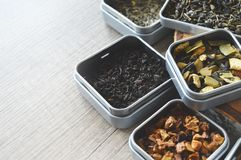 Different types of tea. Different types of loose teas. Black tea with orange, green with fruits, clean green tea and fruit tea and green tea with almonds and stock photography