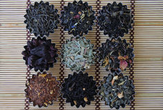 Different types of tea. Photo of different varieties of tea on a bamboo mat Royalty Free Stock Images