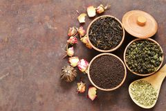 Different types of tea. In a wooden bowl stock images