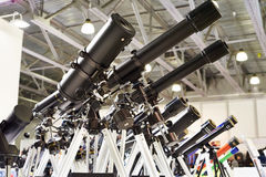 Different types of telescopes at exhibition Stock Photos