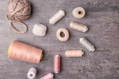 Different types of threads on grey background, Royalty Free Stock Photography