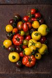 Different types of tomatoes on rusty background Royalty Free Stock Image