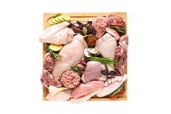 Different types of turkey meat and chicken, steaks, carcass poultry for cooking. Top view on a wooden board, isolate on a white background. Flat lay, cooking stock photography