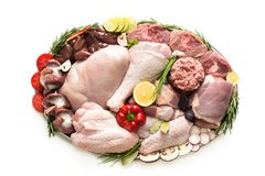Different types of turkey meat and chicken, steaks. Carcass poultry for cooking, top view on a wooden board, isolate on a white background. Flat lay, cooking royalty free stock image