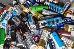 Different types of used batteries ready for recycling lying in a Stock Photography