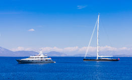 Different types of yachts traveling Stock Image