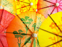Different umbrellas for cocktail Stock Images