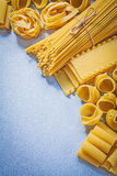 Different uncooked macaroni on blue background food and drink co Stock Image