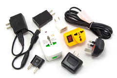 Different universal adapters Travel adapters Stock Photos