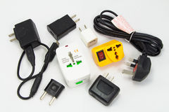Different universal adapters Travel adapters Stock Images