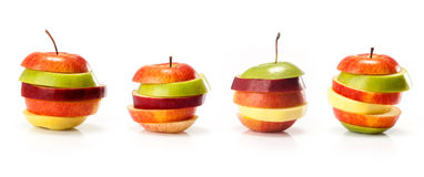 Different varieties of apples cut intp slices. Different varieties of apples cut into slices isolated on white background Royalty Free Stock Photography