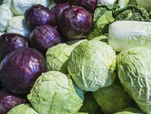 Different varieties of cabbage on the counter market Stock Photography
