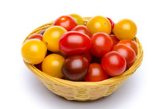 Different varieties of cherry tomatoes in a basket Royalty Free Stock Photo