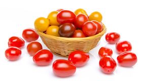 Different varieties of cherry tomatoes in a basket Royalty Free Stock Image