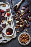 Different varieties of chocolate. White,milk and dark and liquid chocolate . Royalty Free Stock Photo