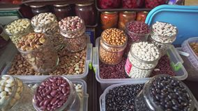 Different varieties of different seeds, beans and nuts on local food market of healthy food. Different varieties of different seeds, beans and nuts on local food stock footage