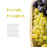 Different varieties of grapes in wicker basket with copyspace white background Stock Photography