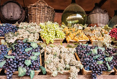 Different varieties of grapes in the wicker baskets, market plac Royalty Free Stock Photo