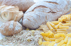 Different varieties of Italian pasta and homemade bread Stock Images