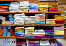 Different variety of colorful towels piled in factory department Royalty Free Stock Image