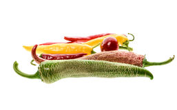 Different variety of hot peppers or chilies, isolated on white. Royalty Free Stock Image
