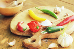 Different variety of hot peppers and spices Stock Photos