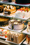 Different Various Types Of Sweet Cakes In Pastry Shop Glass Display Royalty Free Stock Photography