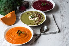 Different vegan food. Colorful vegetables cream soups and ingredients for soup. Healthy eating, dieting, vegetarian. Kitchen and cooking concept Royalty Free Stock Photos