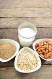 Different vegan milk in glass. Almond milk, sezame milk and oatmeal milk. stock photography
