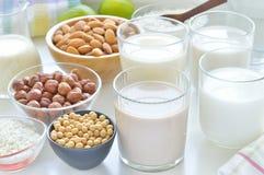Different vegan milks. Stock Photos